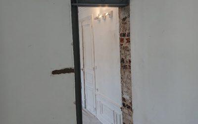 Ouverture de porte dans le mur porteur à Cergy-Pontoise. Renforcement par structure métallique.